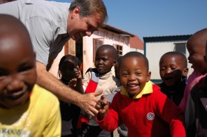 Director Steve Wheeler greeting African Children