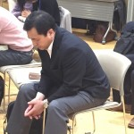 Pastor Tomio Ohashi joins the pastors in the conference in prayer for Japan.