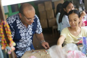 Dr. Granados engages with a worker while exploring ways to help churches minister more effectively through micro enterprises. On a trip in the Philippines.