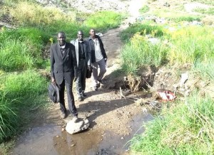 Our Evangelism team (Elijah, John, and Samson) preparing to cross the Luri River for an evangelistic outreach.