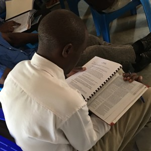 Dedicated student fills his lap to study the Bible